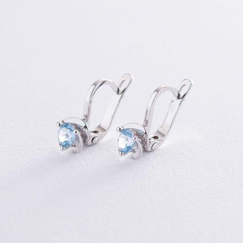Золотые серьги с голубым топазом. с02407