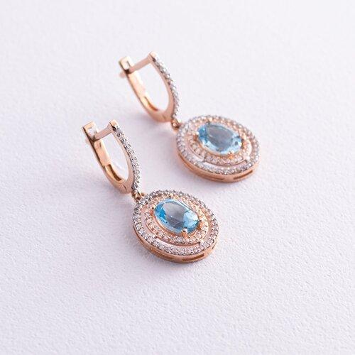 Золотые серьги с голубым топазом и фианитами с04187