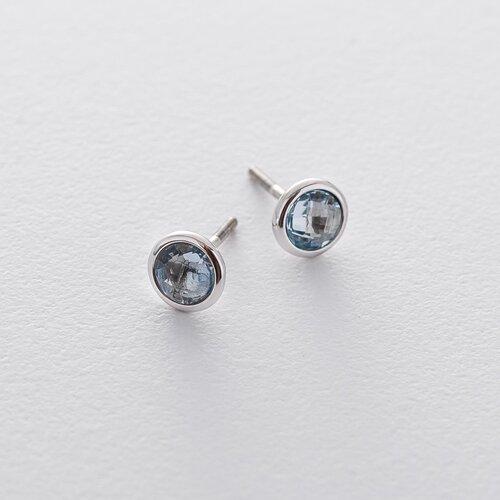 Золотые серьги-пусеты с голубым топазом с06296